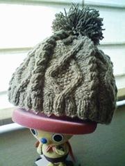 ボンボン付きの帽子